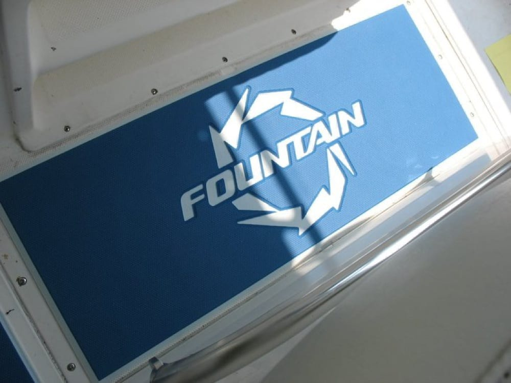 A custom 13mm helm pad with the Fountain Boats logo